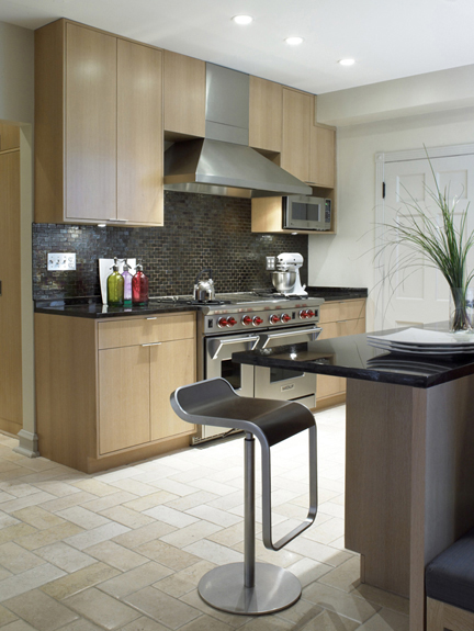 custom rift cut white oak kitchen with Wolf stove