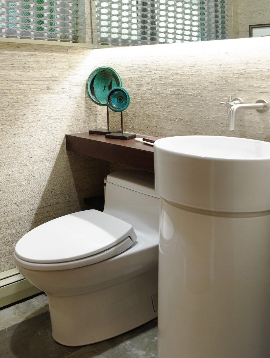powder room with light green grasscloth walls, round pedestal sink