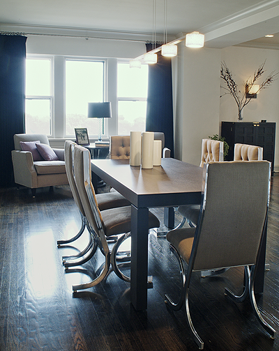 Dining room with vintage chrome chairs and blue velvet drapery