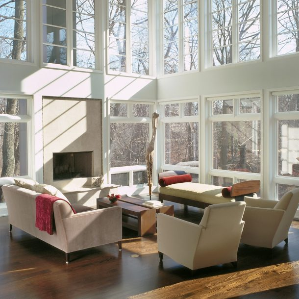 living room with large floor to ceiling windows, volume seating, fireplace, Donghia chairs, christian liagre bench
