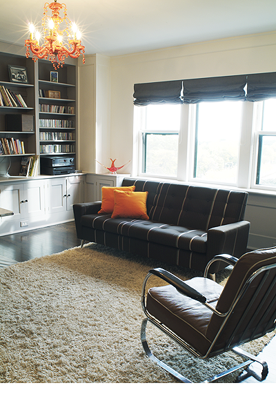 Home office with vintage furniture and sofa covered in Maharam fabric