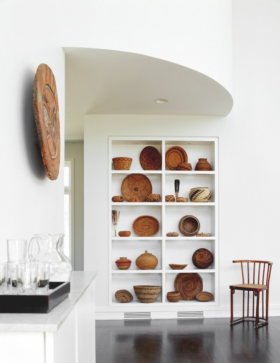 collection of Native American art and baskets on white shelving