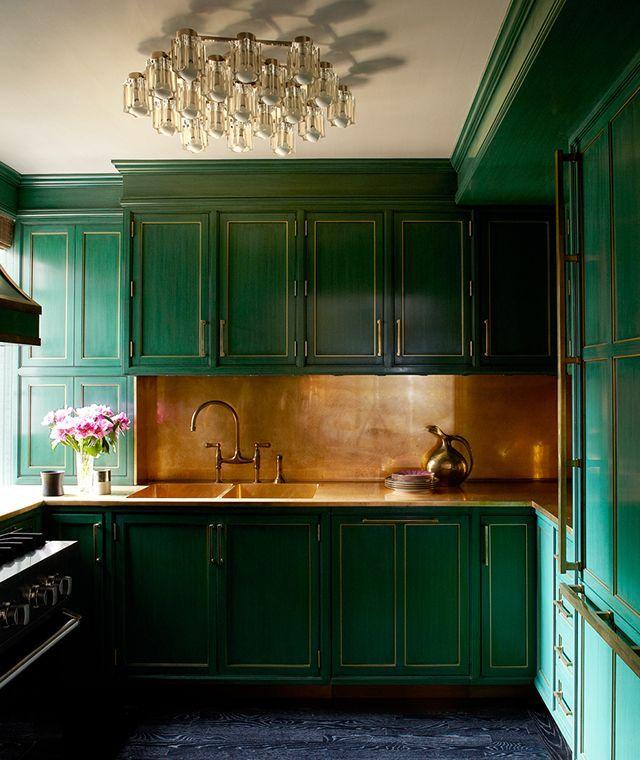 green painted kitchen with brass backsplash