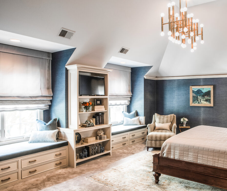 primary bedroom with blue grass cloth wallpaper, jonathan adler light fixture