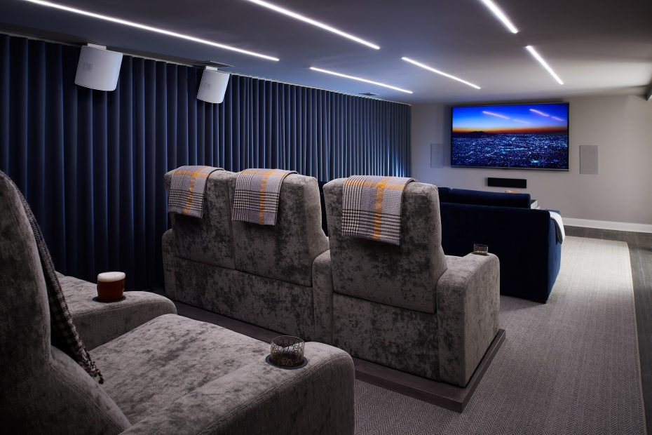 screening room with theater seats, blue drapery