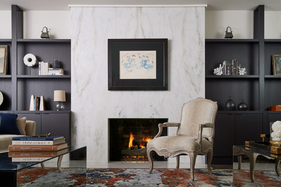 fireplace with book matched imperial danby stone, dark brown bookshelves