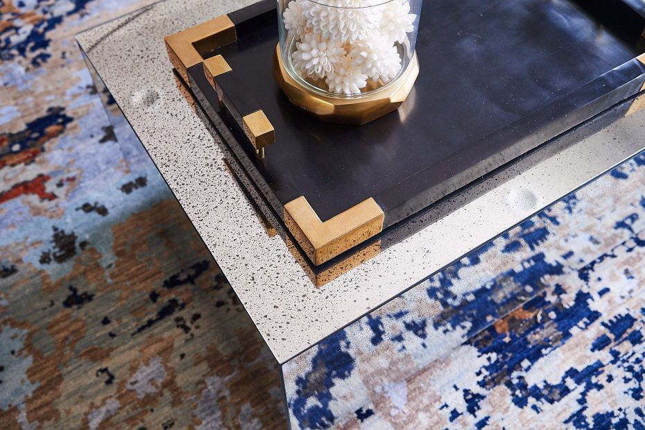 mirrored glass coffee table with a dark tray