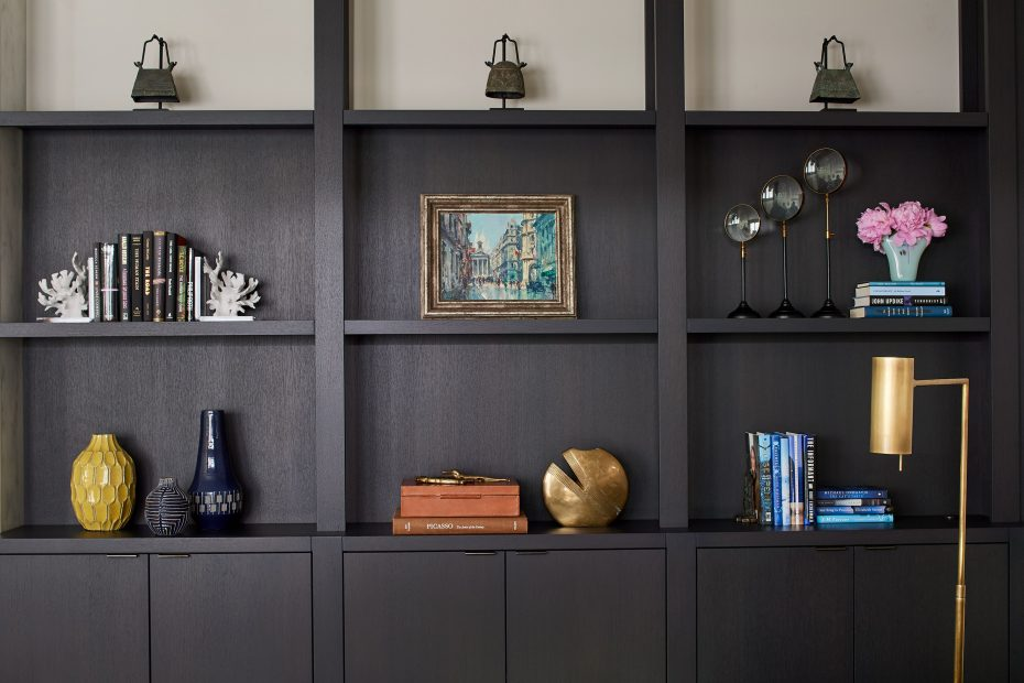 dark mahogany stained bookshelves with objects