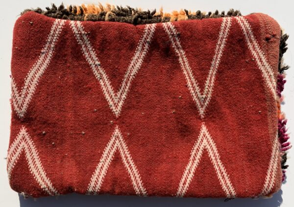 "One of a kind. Moroccan pillow made from antique hand woven rugs, 2 sided pillow - plush wool on one side and flat wool on the opposite. 17 ""x 11.5"". SKU 143-09. $105. Insert $50"