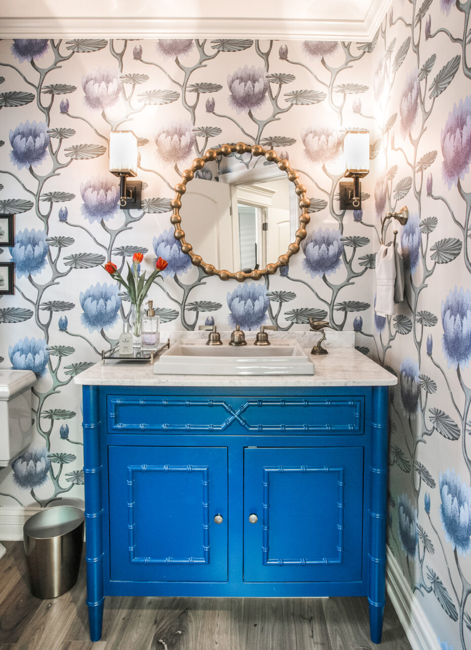 powder room with a j. tribble blue vanity, cole and sons wallpaper, circa lighting