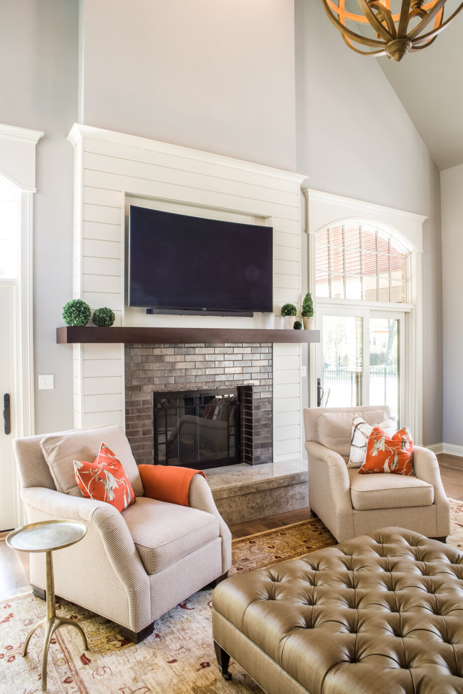 fireplace with shiplap surround and glazed tile