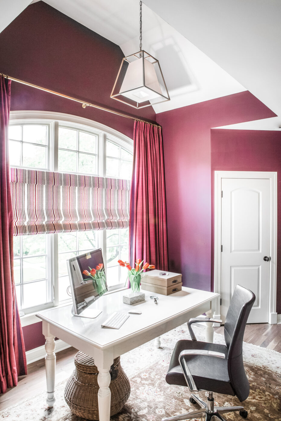 farrow and ball brinjal paint, magenta color walls, office with a white desk and colorful window treatments