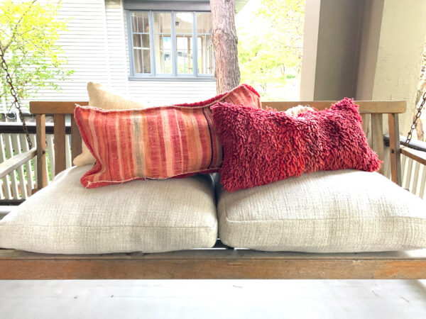 Group of Moroccan pillows. Each pillow is one of a kind. Moroccan pillow made from antique hand woven rugs, 2 sided pillow - plush wool on one side and flat wool on the opposite.