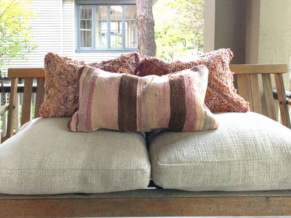 One of a kind. Moroccan pillow made from antique hand woven rugs, 2 sided pillow - plush wool on one side and flat wool on the opposite.